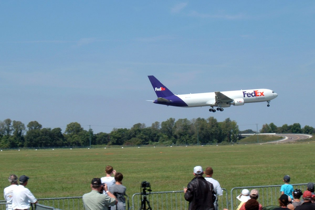 FedEx Boeing 767 departing the runway at the Memphis Millington Airport (NQA) with spectators in the background