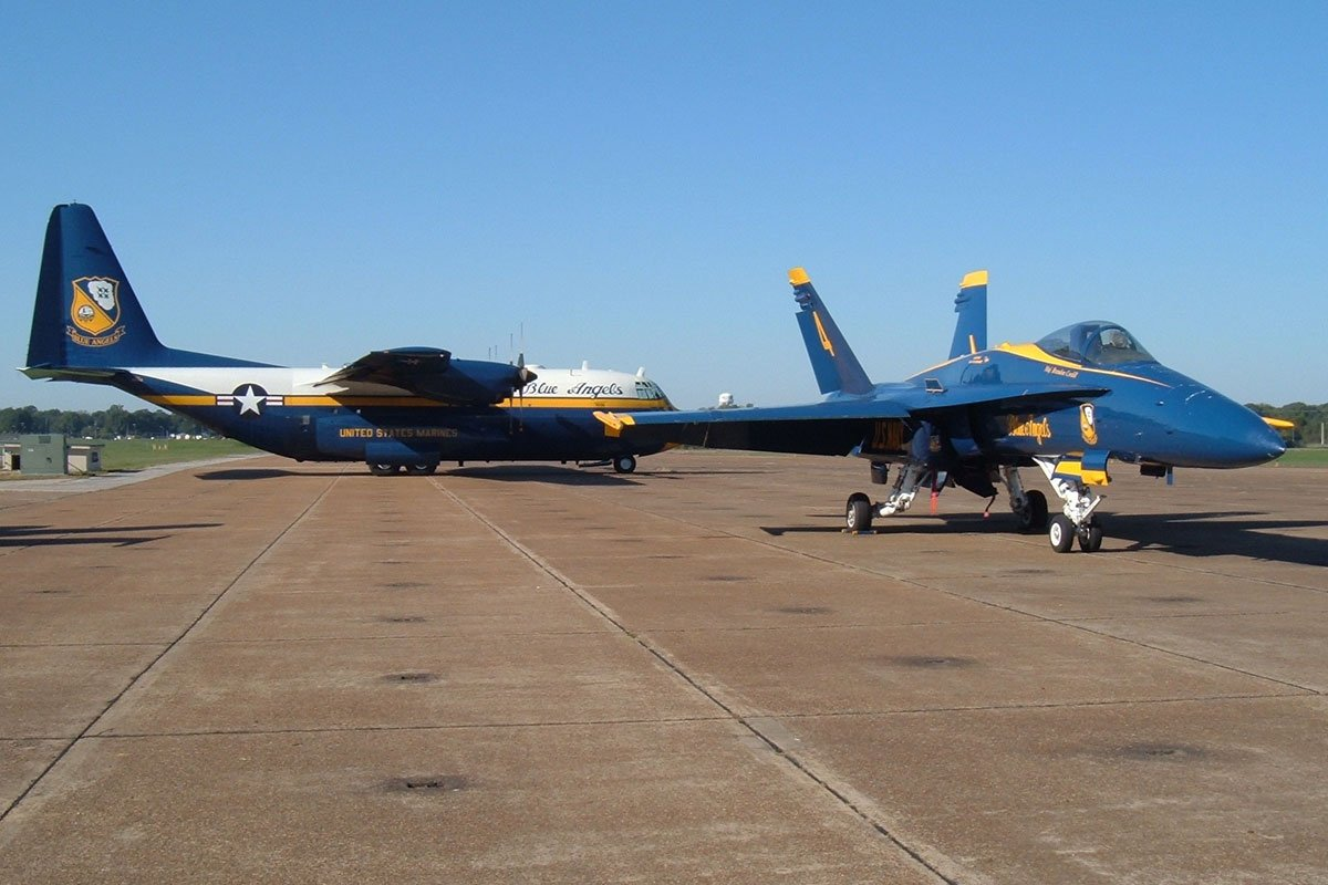 US Navy Blue Angels Fat Albert and F/A 18 Hornet parked on the ramp at the Memphis Millington Airport for the airshow events